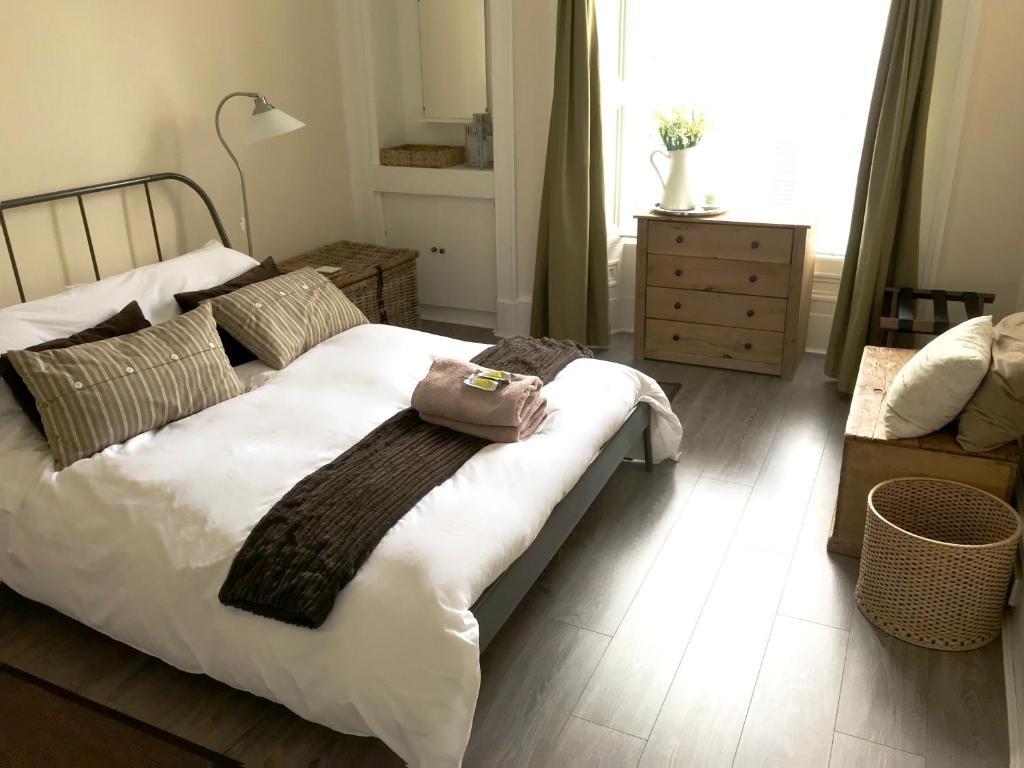 Ein Bett oder Betten in einem Zimmer der Unterkunft Apartment Old Edinburgh