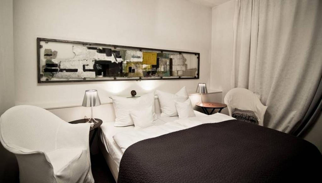 Ein Bett oder Betten in einem Zimmer der Unterkunft Domizil Regensburg