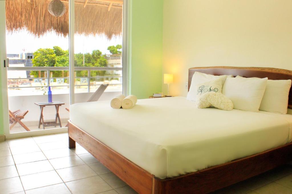 Cama o camas de una habitación en La Palmita Budget Boutique Hotel