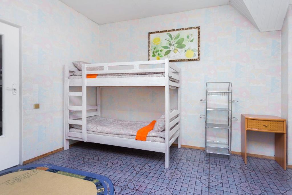 Ein Etagenbett oder Etagenbetten in einem Zimmer der Unterkunft Hostel