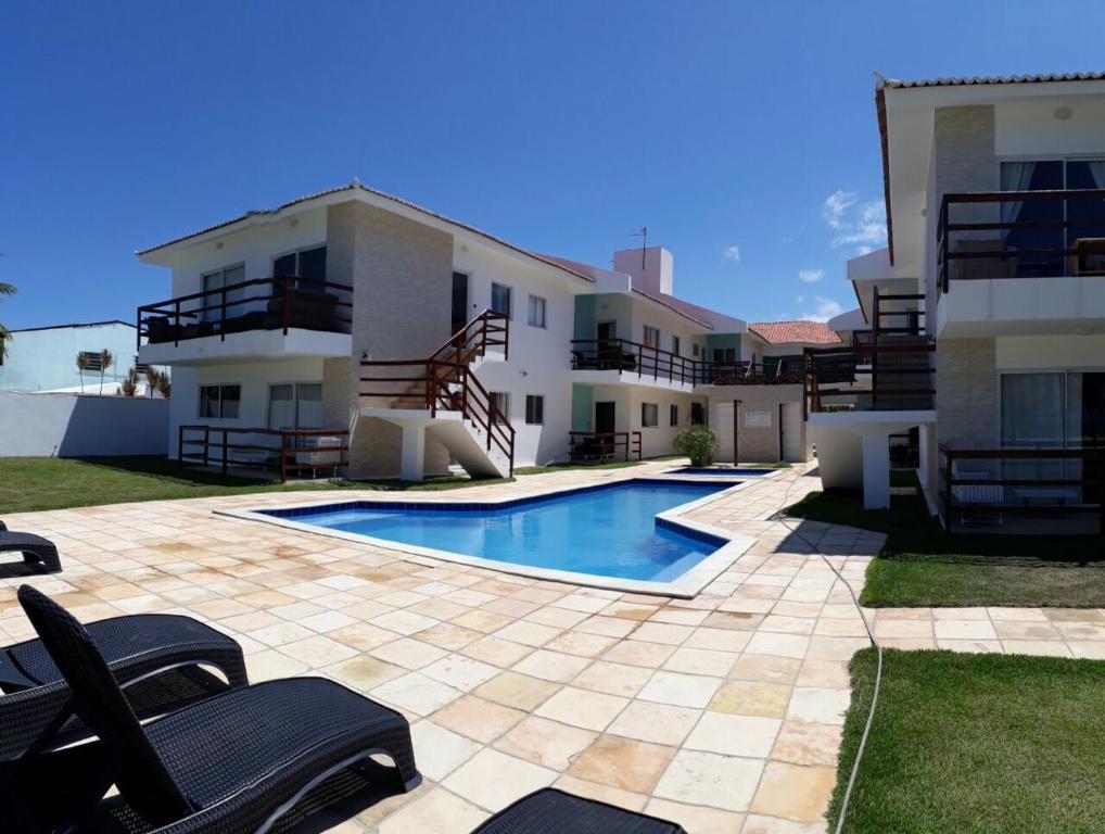 A piscina localizada em Manga Verde Itamaraca Apartamento 06 ou nos arredores