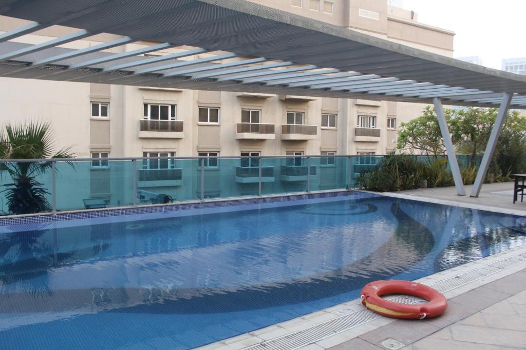The swimming pool at or near OYO 133 Home Barsha apartments