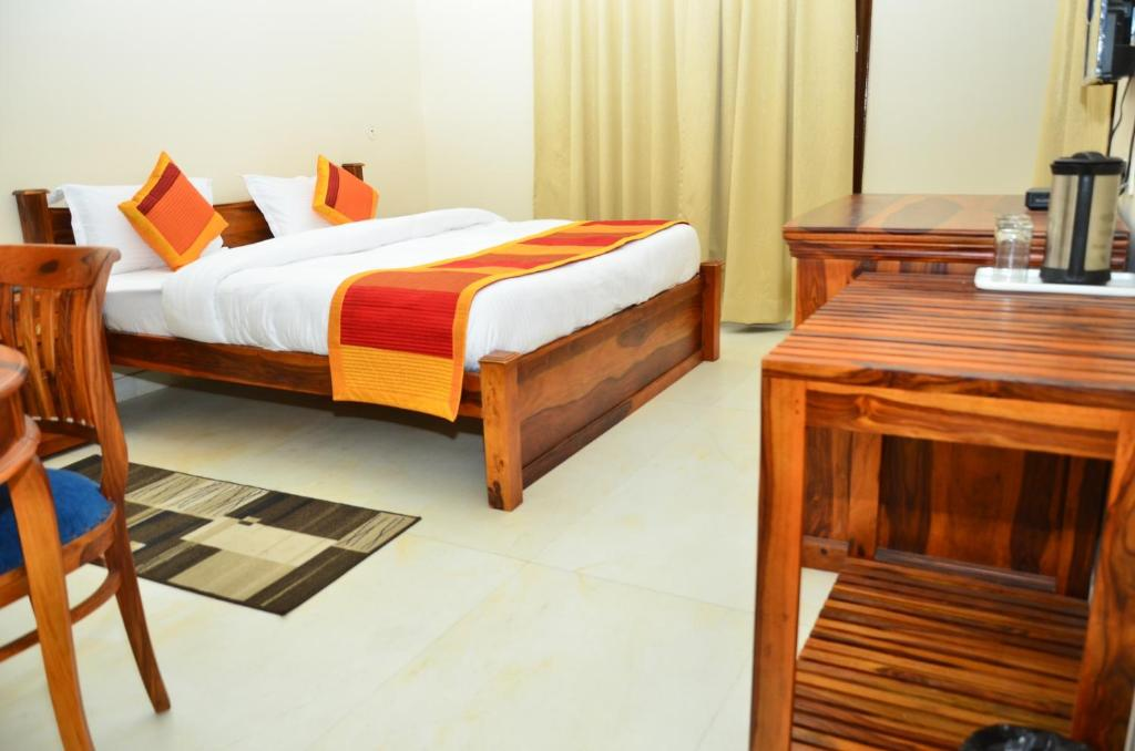 A bed or beds in a room at M Villa-Airport Hotel