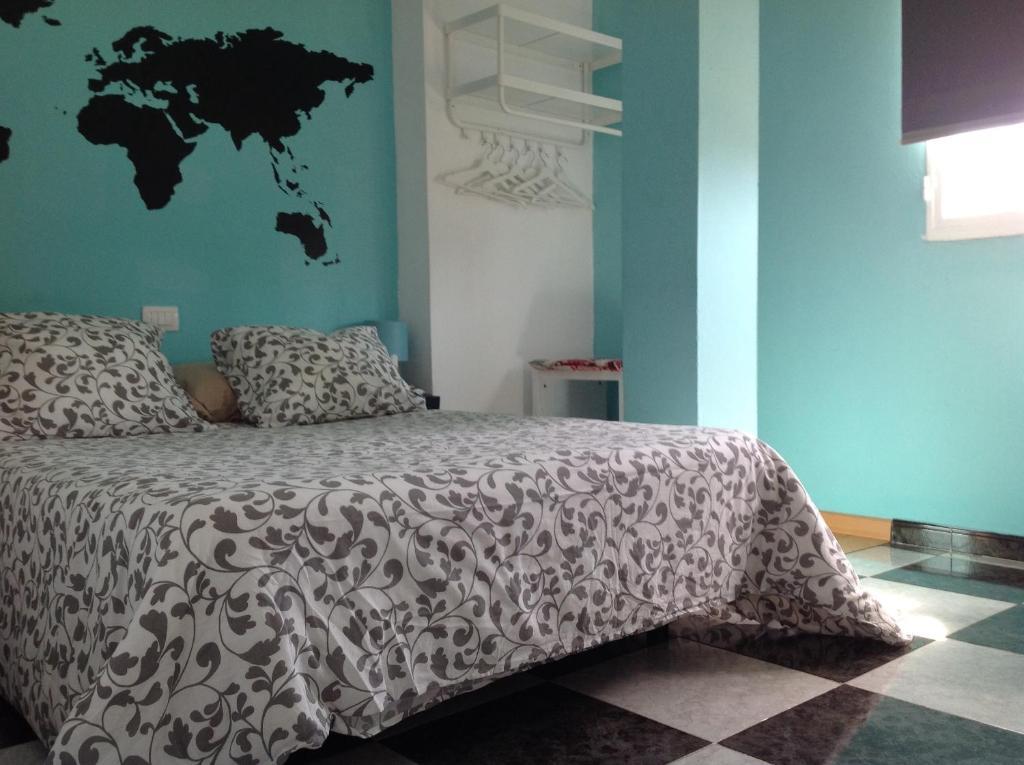 Letto o letti in una camera di Aloja cerca del aeropuerto