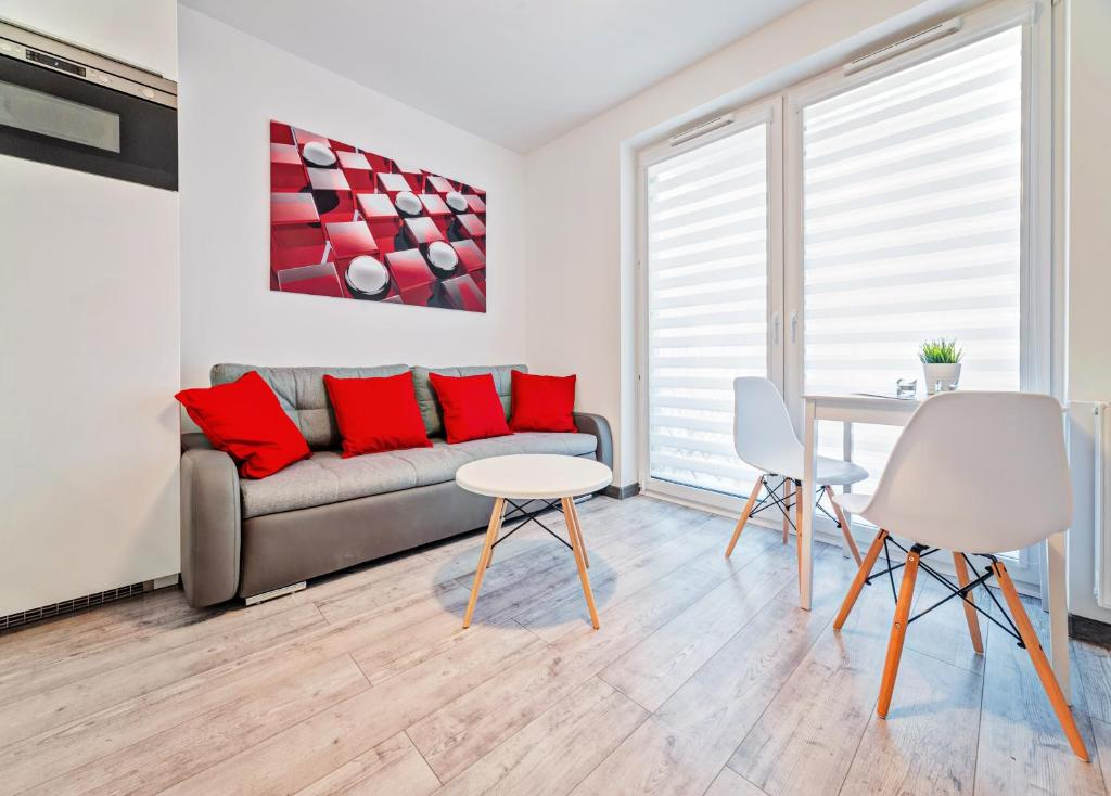 A seating area at Good Time Apartments Strzelecka III