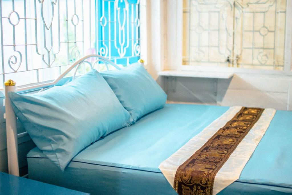 A bed or beds in a room at Villa Siam & Spa