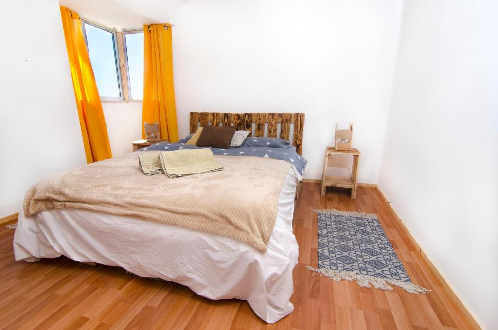 A bed or beds in a room at Mi Paz