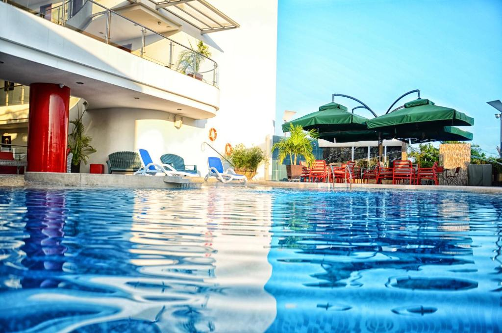The swimming pool at or near Hotel Atrium Plaza