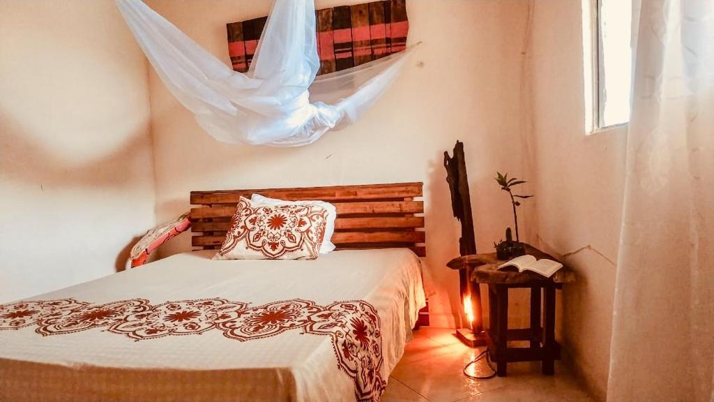 Cama o camas de una habitación en El Valle De Bahia Hostel