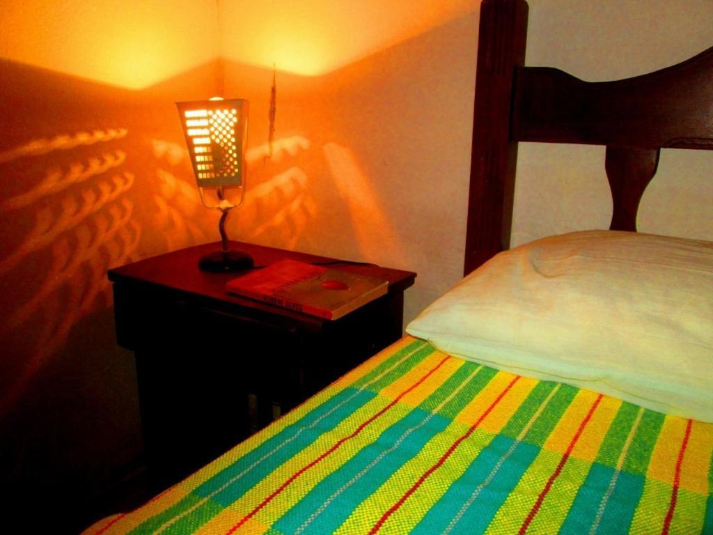 A bed or beds in a room at Cama, Café e Aventura