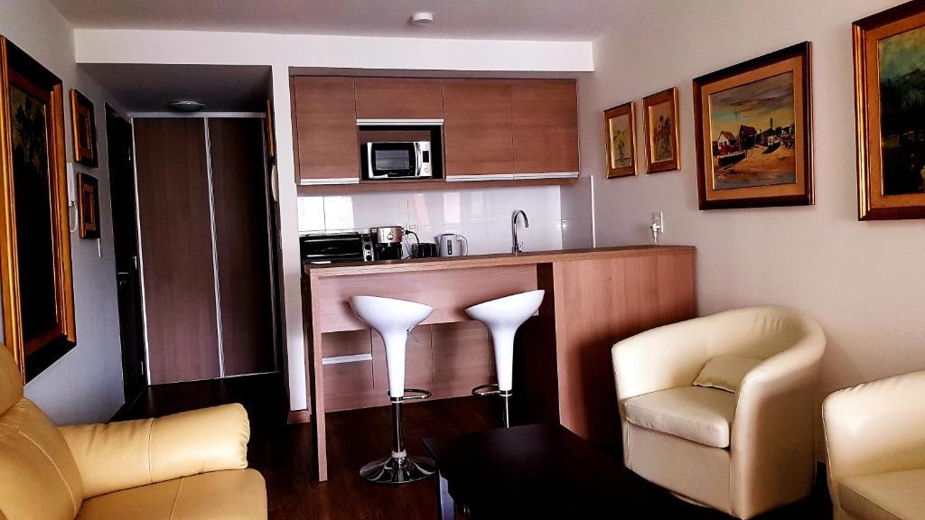A kitchen or kitchenette at Studio apartment, Pocitos