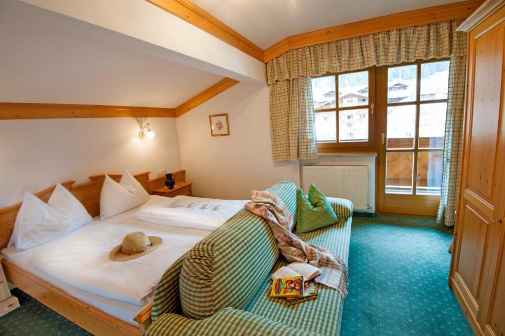 Ein Bett oder Betten in einem Zimmer der Unterkunft Appartementhaus Lackner
