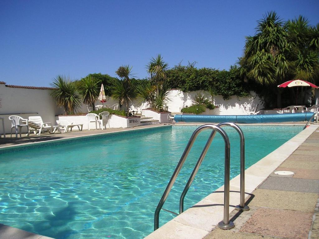 The swimming pool at or near Pine Lodge