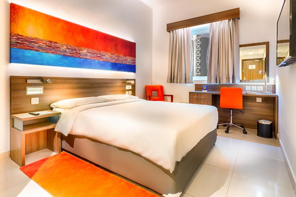 Un pat sau paturi într-o cameră la Citymax Hotel Bur Dubai