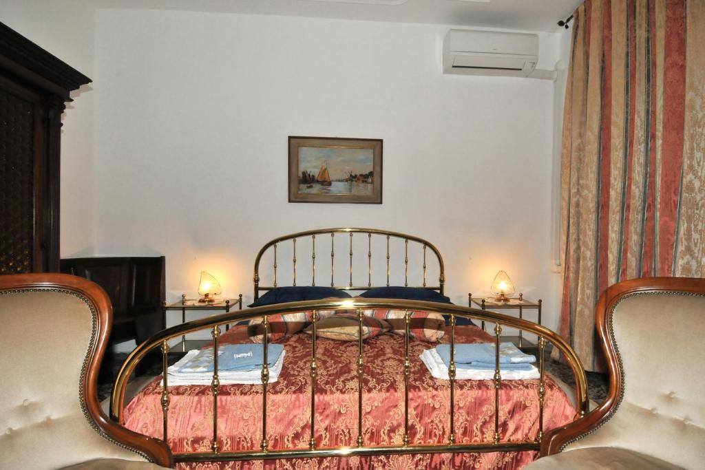 Cama o camas de una habitación en Locazione Turistica Poker d'assi