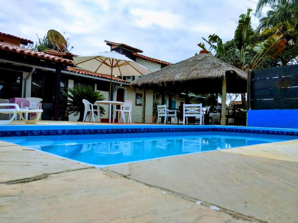 The swimming pool at or near Pousada Ohana Búzios