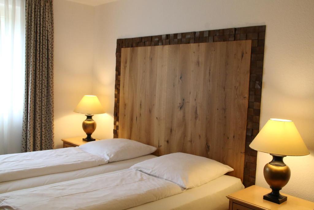 Ein Bett oder Betten in einem Zimmer der Unterkunft Gästehaus Bavaria