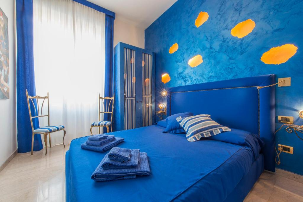 A bed or beds in a room at Luxury Apartment - Boccaccio Blue