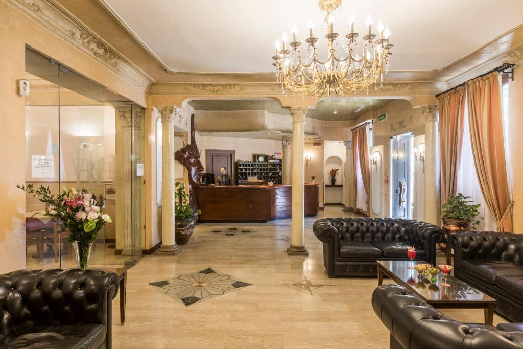The lobby or reception area at Hotel Villa Rosa