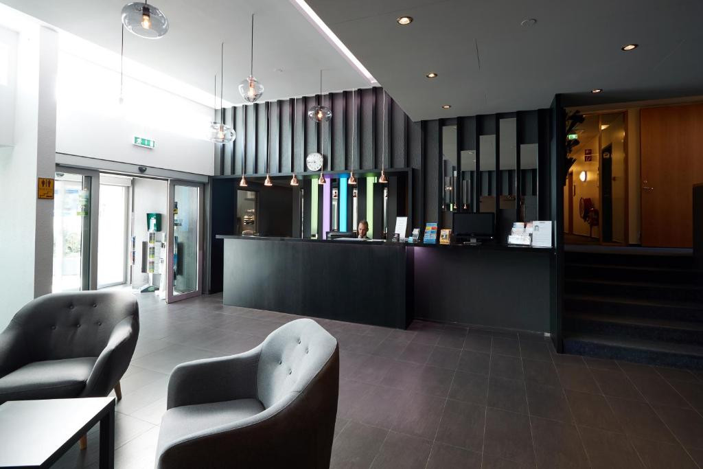 The lobby or reception area at Fosshotel Lind