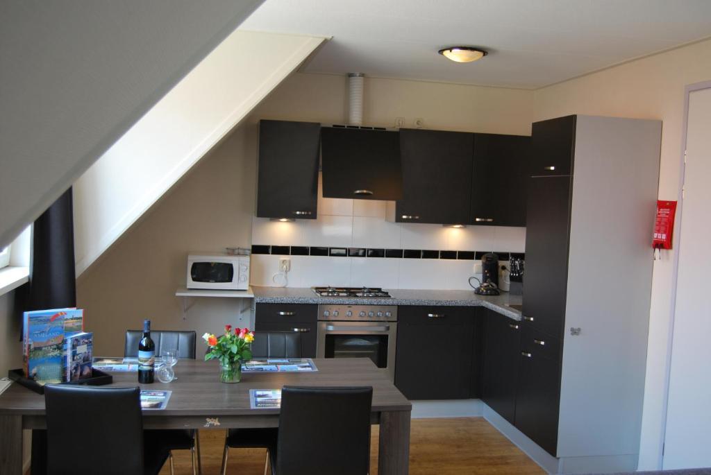 Een keuken of kitchenette bij Wijnberg Appartementen