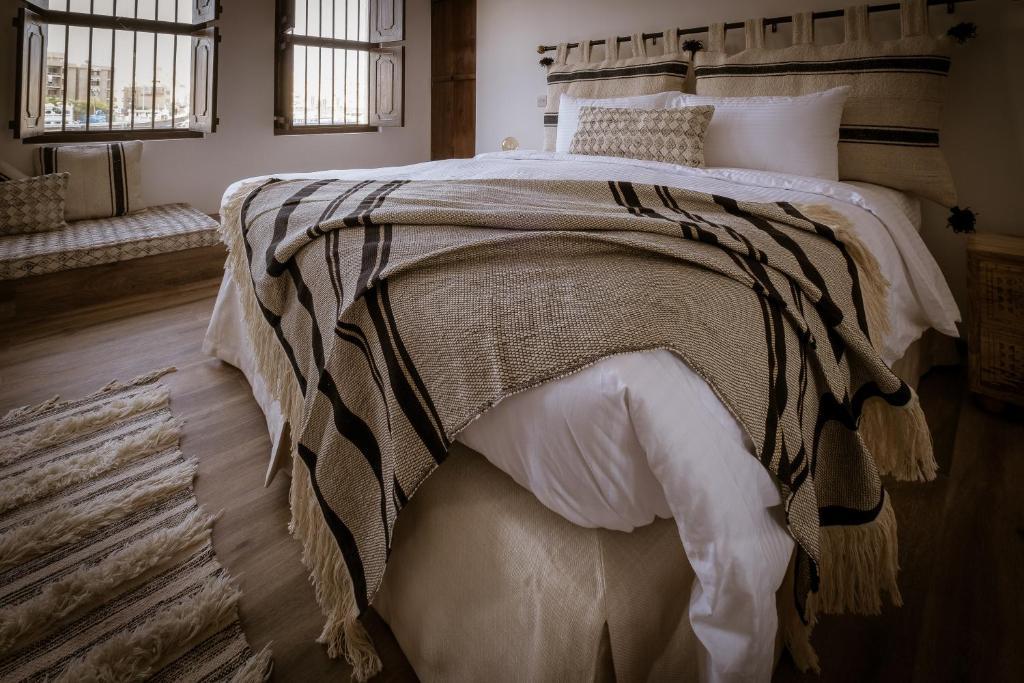 Un ou plusieurs lits dans un hébergement de l'établissement MAZMI CASA
