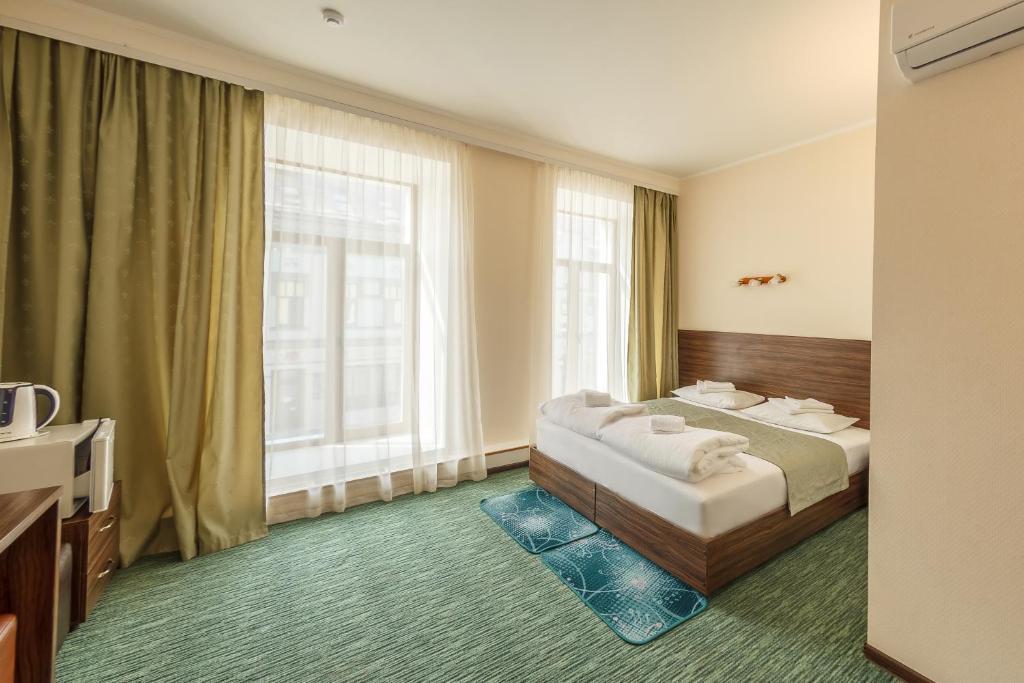 Un ou plusieurs lits dans un hébergement de l'établissement Almaz Hotel