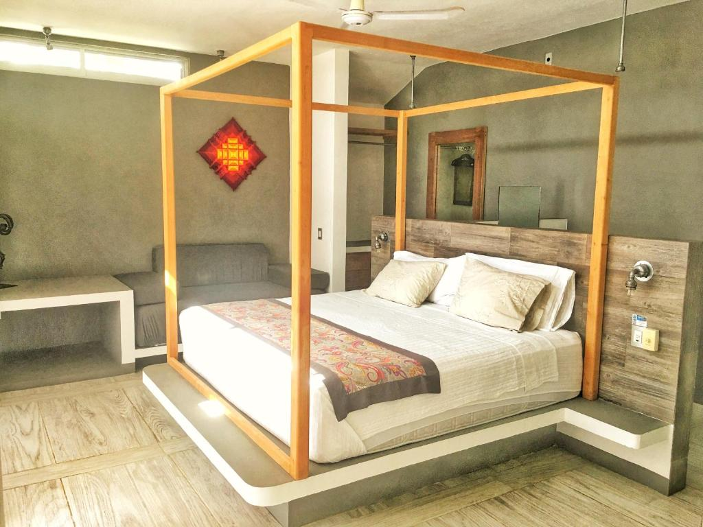 A bed or beds in a room at Villa Aikia (Adults Suites A/C)
