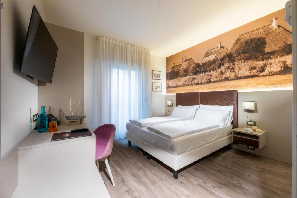 Ein Bett oder Betten in einem Zimmer der Unterkunft Hotel Casa Costiera
