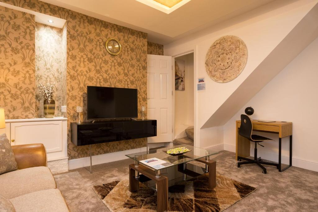 A television and/or entertainment center at Landmark Apartments Harrogate