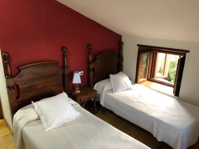 A bed or beds in a room at Casa Navarro