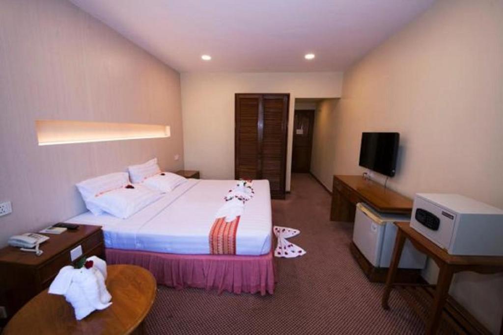 Łóżko lub łóżka w pokoju w obiekcie Panorama Hotel