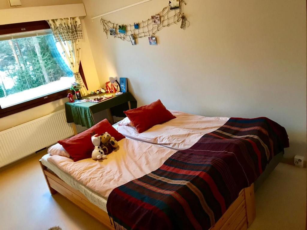 A bed or beds in a room at Snowman House in Rovaniemi