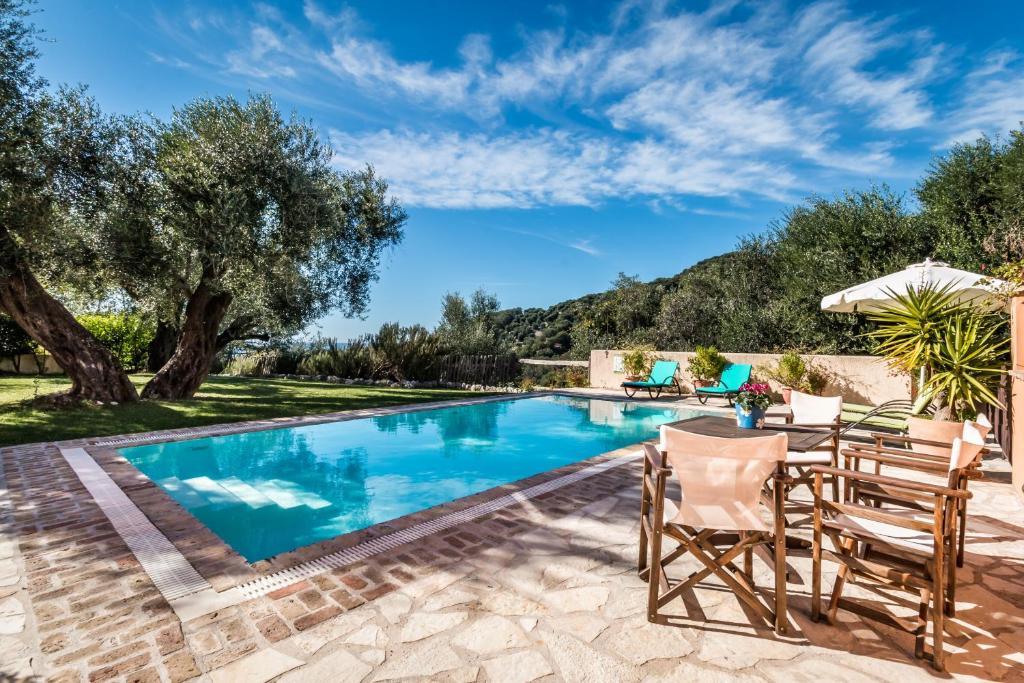 The swimming pool at or close to Mastrogiannis Villa Levanda