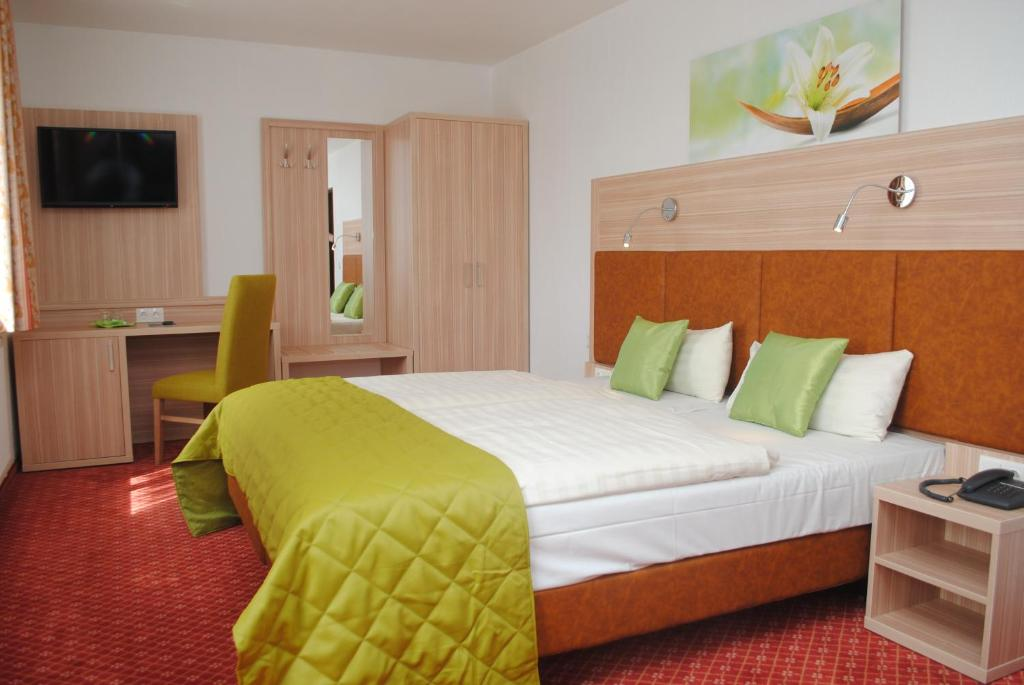 Ein Bett oder Betten in einem Zimmer der Unterkunft City Hotel Lippstadt