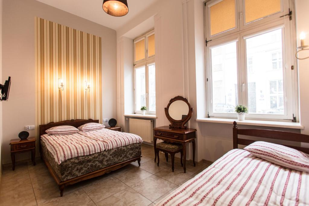 A bed or beds in a room at Puffa Hostel Lux