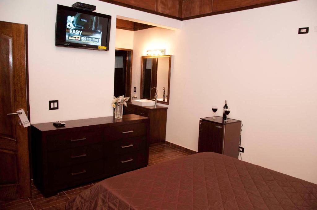 Gulta vai gultas numurā naktsmītnē La Maison Hotel