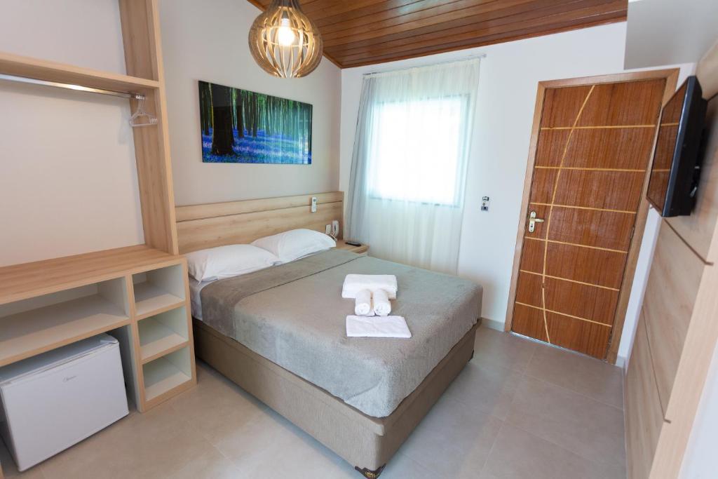 Cama ou camas em um quarto em Pousada Nascer do Sol