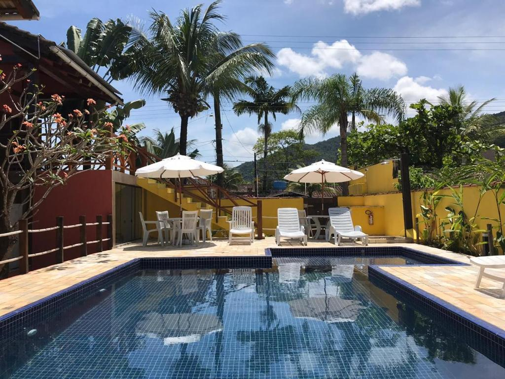A piscina localizada em Pousada Vila do Sol Juquehy ou nos arredores