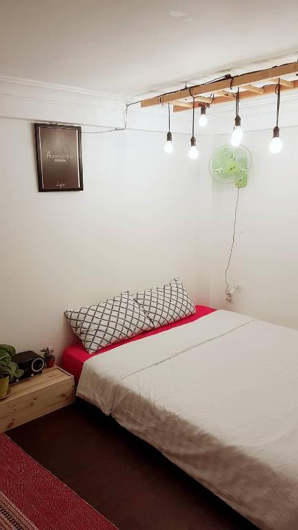 Phòng Giường Đôi Deluxe (2 Người lớn + 1 Trẻ em)