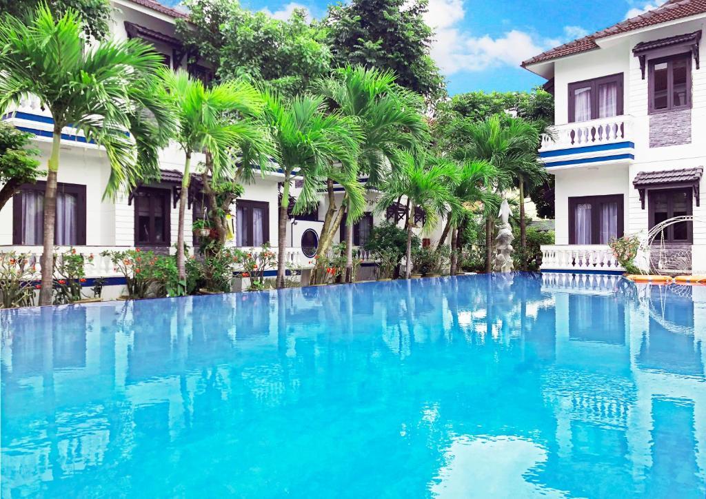 The swimming pool at or near Hoi An Memority Villas & Spa