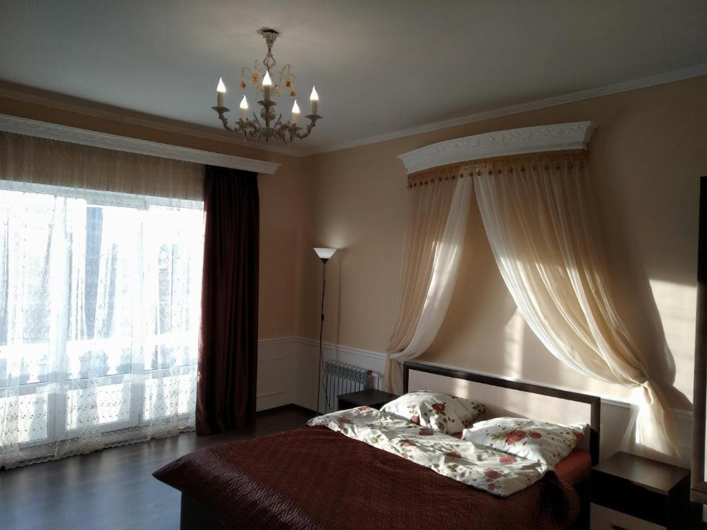 A bed or beds in a room at Holiday Home with Superb Hall