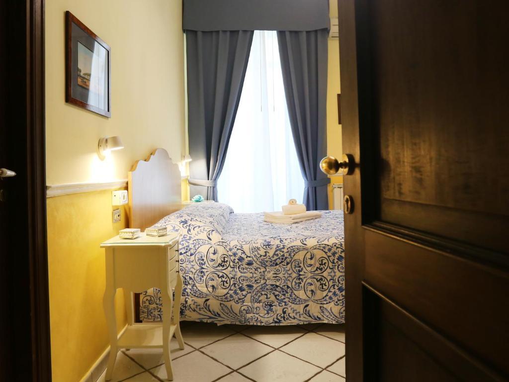 Кровать или кровати в номере Santa Lucia 50