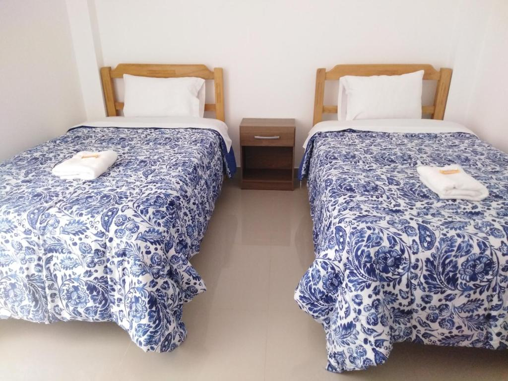 A bed or beds in a room at El Buen Samaritano Backpackers