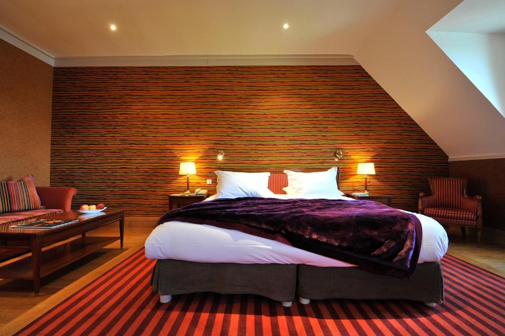 Ein Bett oder Betten in einem Zimmer der Unterkunft Hôtel & Spa de La Bretesche