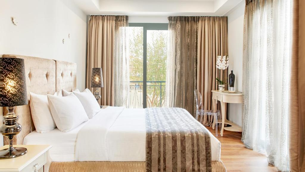 A bed or beds in a room at Dioni Boutique Hotel