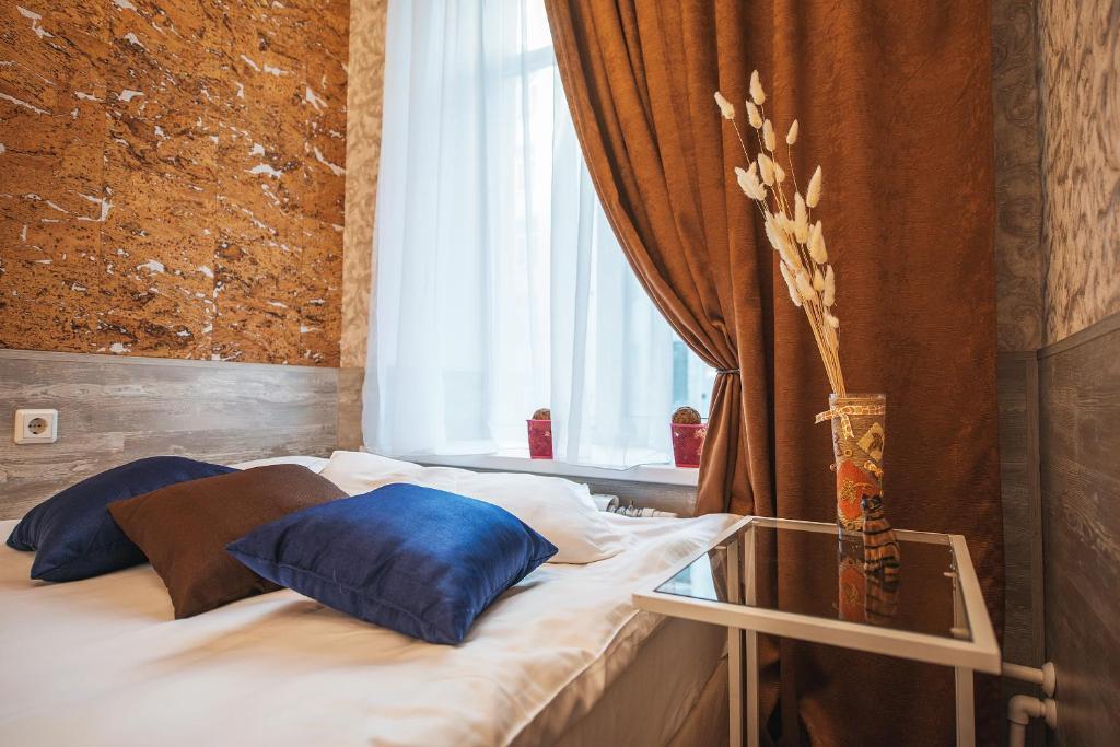 Кровать или кровати в номере Отель Авангард