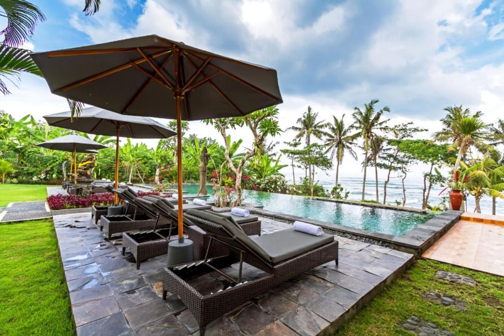 The swimming pool at or near Bali Natha Beach Front