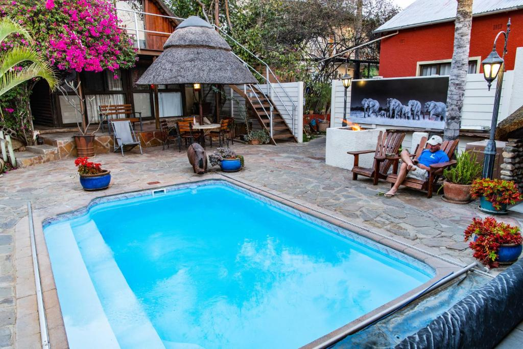 The swimming pool at or near Chameleon Backpackers & Guesthouse