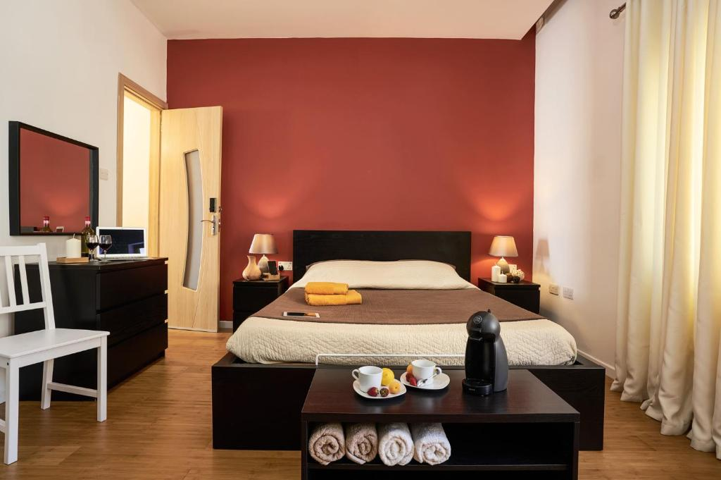 A bed or beds in a room at Sweet Home Malta